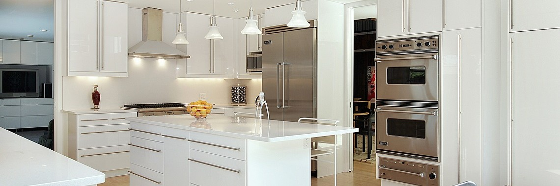 A Modern Kitchen With White Cabinets In Perth
